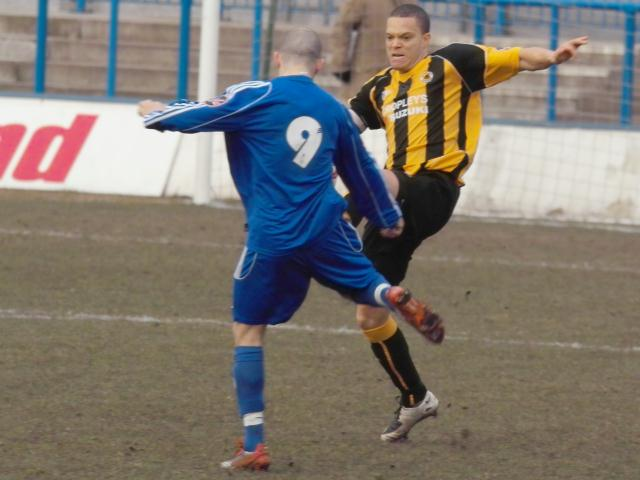 Lee Canoville goes for the ball