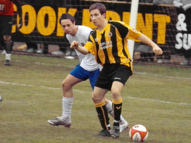 Danny Sleath holds the ball