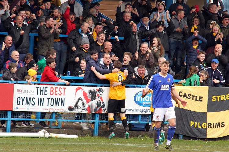 The Boston fans celebrate Dayle Southwell's opening goal