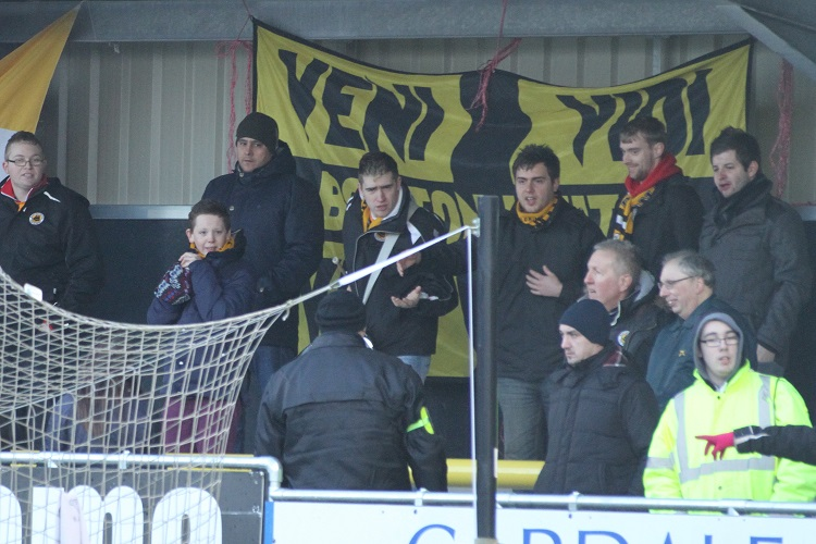 The Boston fans debate with a Harrogate steward