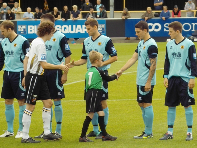 The teams shake hands