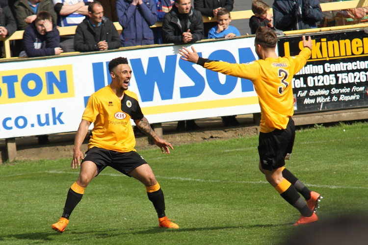 Jay Rollins celebrates the winner