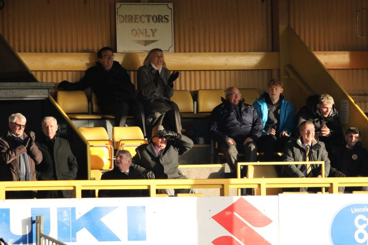 All smiles in the Directors' Box